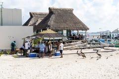 Fishermen sell fresh fish on the beach Stock Photos
