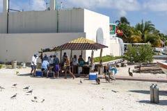Fishermen sell fresh fish on the beach Stock Photo