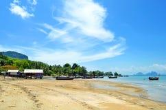 Fishermen shacks and boats at low tide at Mook island Royalty Free Stock Photo