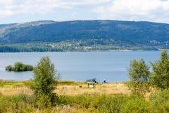 Fishermen on the shore of Lake Vlasina in Serbia Stock Photos