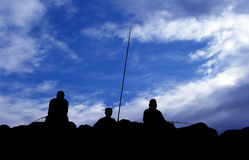 Fishermen silhouette Stock Photos