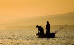 Fishermen silhouette Stock Photos