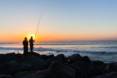 Fishermen Silhouetted Ocean Beach Sunrise Royalty Free Stock Image