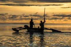 Fishermen silhouettes at sunrise stock image