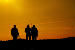 Silhouettes of three fishermen. With rod and line at sunset in Swedish Lapland stock photo