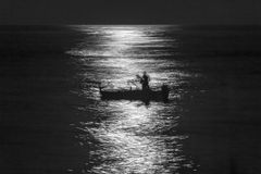 Fishermen Silouette at Full Moon Royalty Free Stock Image