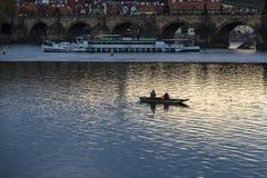 Fishermen in small boat fishing near the Charles Bridge Royalty Free Stock Image