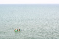 Fishermen on small boat in the sea Stock Images