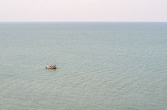 Fishermen on small boat in the sea Stock Photography