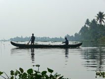 Fishermen in a small boat royalty free stock photos