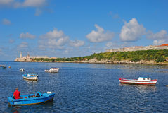 Fishermen in small boats with Morro Castle on the left and Fort of Saint Charles on the right in the background Royalty Free Stock Photos
