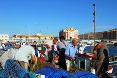 Fishermen sorting nets, Spain. Stock Image