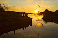 Silhouette,Sunset,Fisherman,pastime,job. Special fishing systems called  balance Stock Images