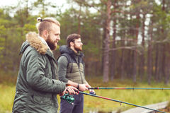 Fishermen with a spinning rod catching fish on a river Stock Photos