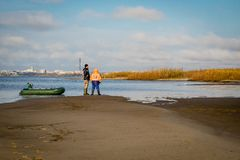 Fishermen with inflatable boat royalty free stock image
