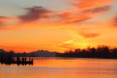 Fishermen, Steveston Harbor Sunrise. Fishermen line up on the floating dock in Steveston trying their luck at sunrise. Richmond, British Columbia, Canada Royalty Free Stock Photo