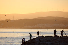 Fishermen at the sunrise Stock Image
