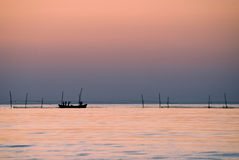 Fishermen at sunrise Stock Images