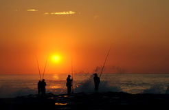 Fishermen at sunrise Stock Photography
