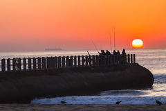 Fishermen Sunrise Ocean Jetty Royalty Free Stock Images