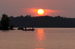 Fishermen at sunset. Two men fishing on a remote Wisconsin lake at sunset Royalty Free Stock Image