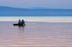 Fishermen after sunset. Fishing at Lake Balaton in Hungary after sunset stock photo