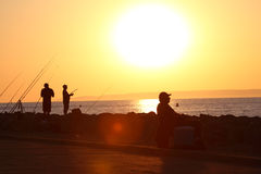 Fishermen in the sunset Royalty Free Stock Images