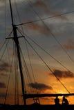 Fishermen at sunset Stock Image