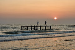 Fishermen at sunset. Stock Photo