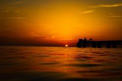 Fishermen at sunset Royalty Free Stock Images