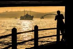 Fishermen on sunset Stock Photo