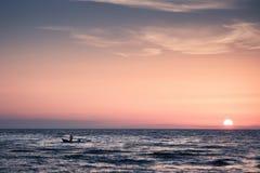 Fishermen at sunset Royalty Free Stock Image
