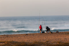 Fishermen Surf Waves Sunrise Beach Holidays Royalty Free Stock Photography