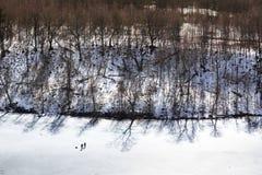 Fishermen on the surface of  frozen lake Stock Photos