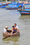 Fishermen are swimming from their vessels to the seaport in a basket boat Stock Photo
