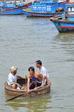 Fishermen are swimming from their vessels to the seaport in a basket boat Royalty Free Stock Photo
