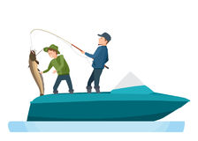 Fishermen take fish, caught on spinning, putting catfish in boat. Fisherman`s set on fishing in different situations. Young fishermen take a big fish, caught on Stock Photography
