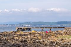 Fishermen taking advantage of the Good Weather at Portencross Jetty and Harbour Scotland on a Bright Cold Day. Seamill, Scotland, UK - April 05, 2019: Some stock image