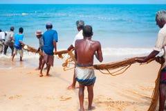 Fishermen at teamwork. Sri Lanka Stock Photos
