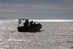 Fishermen in their boat Stock Photography