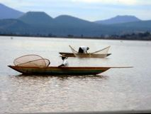 Fishermen in their daily fishing. Fishermen with their boats and nets fishing in the traditional way in the lake of patzcuaro Stock Photo