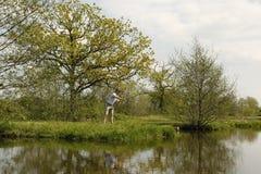 Fishermen throws the fishing rod Stock Image