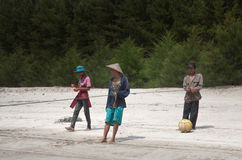 Fishermen on Tiku beach Stock Photos