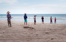 Fishermen on Tiku beach Royalty Free Stock Images