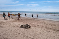Fishermen on Tiku beach Stock Images