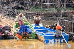 Fishermen at Tonle Sap, Cambodia royalty free stock photo