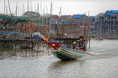 Fishermen in Tonle Sap, Cambodia Royalty Free Stock Images