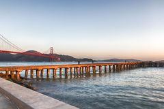 Fishermen at Torpedo wharf. Fishermen at Torpedo wharf Crissy Field vey early in the morning, Golden Gate Bridge, San Francisco Stock Photography