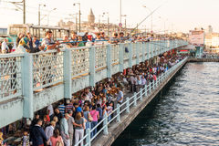 Fishermen and tourists are on the Galata Bridge in Istanbul Royalty Free Stock Photos