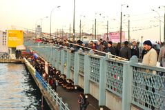 Fishermen and tourists on the Galata Bridge, Istanbul, Turkey